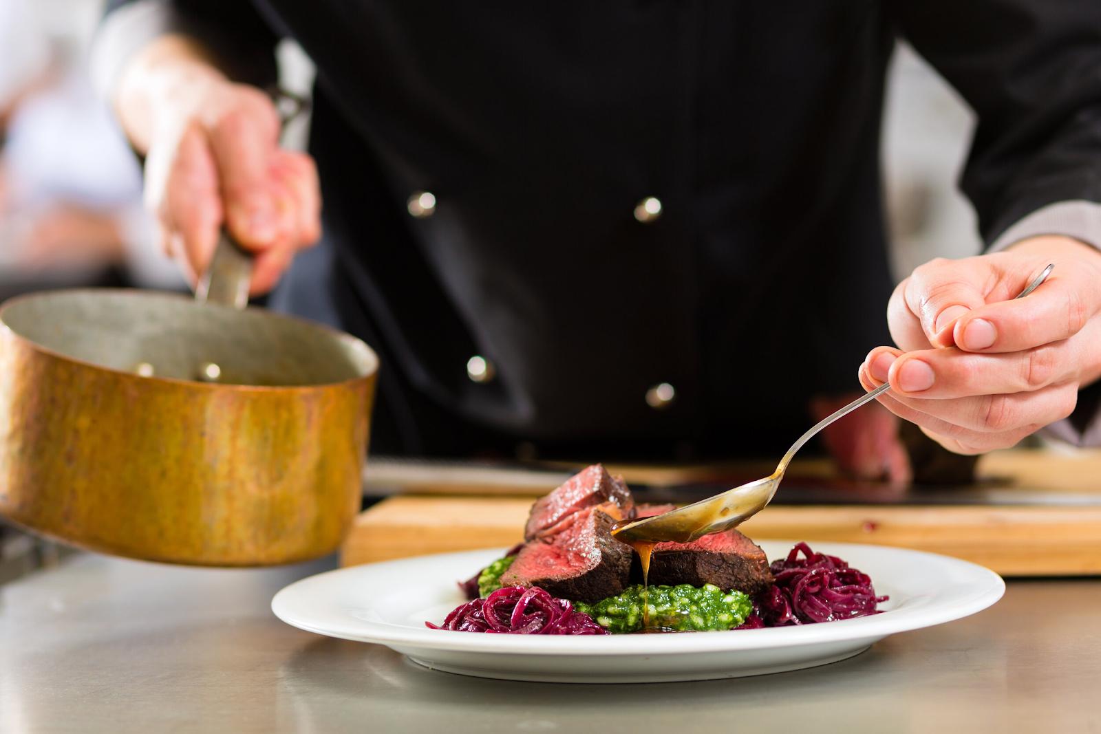 a chef basting a steak