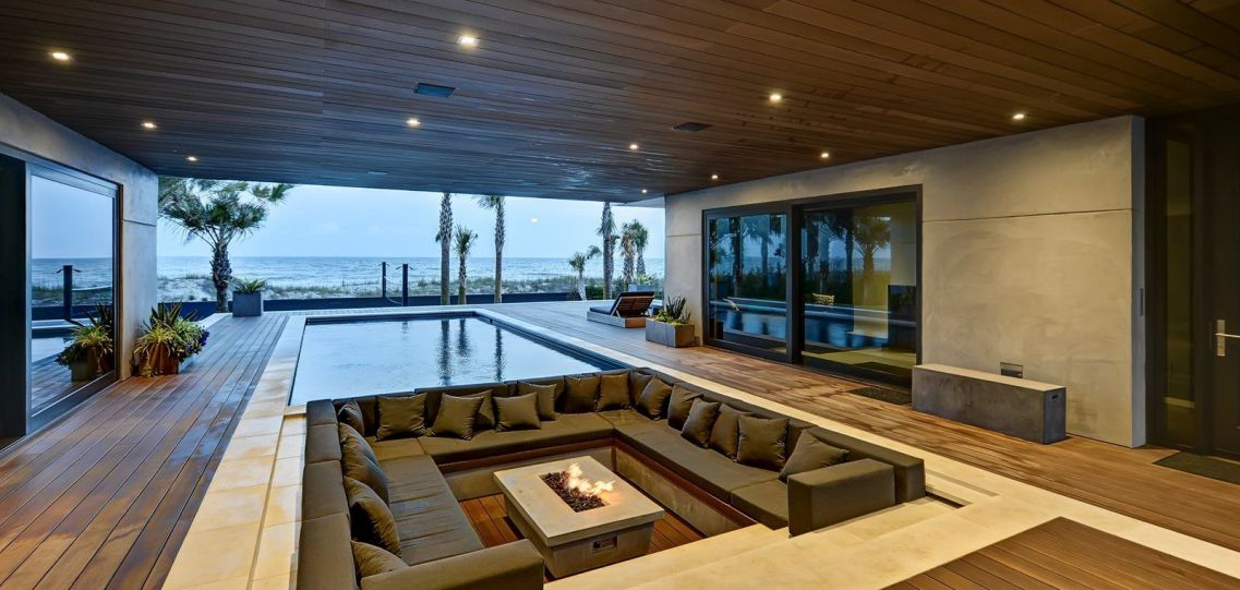 Luxury home interior designer and celebrity interior designer use features such as indoor conversation fire pits to make luxury interiors both fun and functional